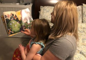 child reading with mother