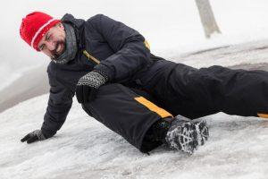 man falls on ice
